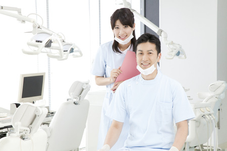 Dentist and dental hygienist of smile 版權商用圖片 - 43740189