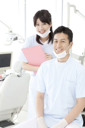 Dentist and dental hygienist of smile