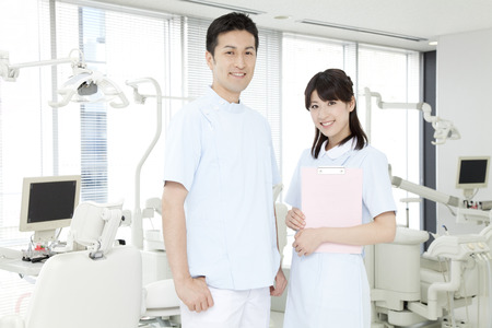 Dentist and dental hygienist of smile