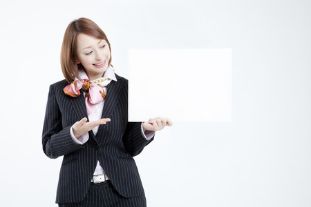 message board: Business woman with a message board