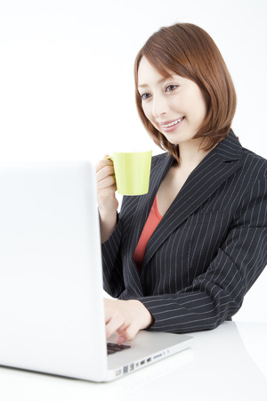 Businesswoman working with laptop photo
