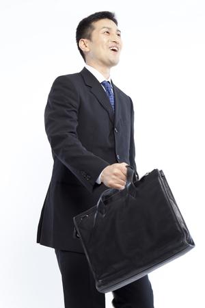 feeling happy: Businessman walking