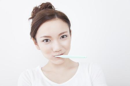 loosen up: Women brush their teeth