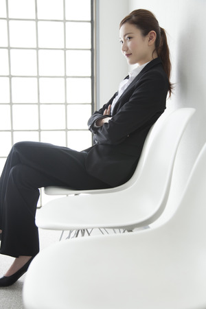 sits on a chair: OL sits on a Chair Stock Photo