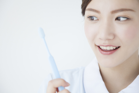hygienist: Dental hygienist with a toothbrush