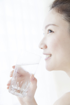 asian style: Woman drinking water Stock Photo