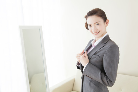 changing clothes: Women dressed in suits