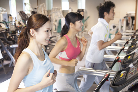 Men and women to exercise at the gym