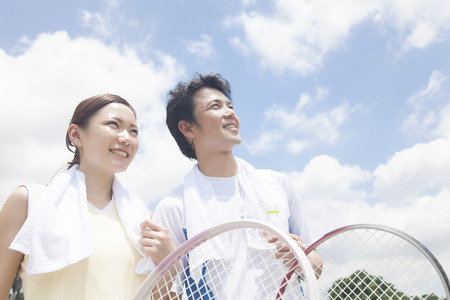 Men and women with a tennis racket Stok Fotoğraf