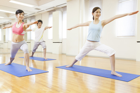 Men and women to do yoga
