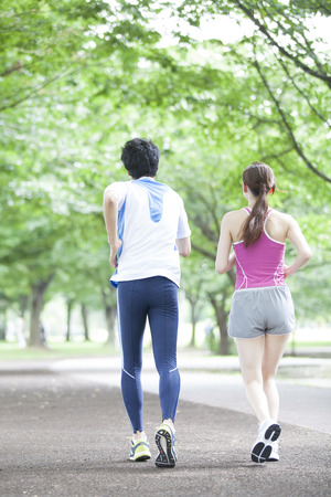 Men and women from behind to jogging