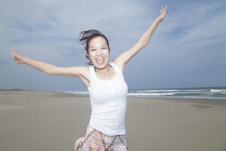 frolic: Female frolic on the beach.