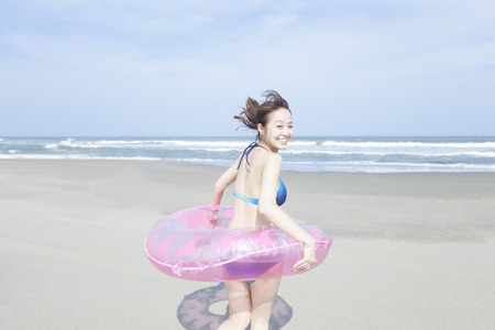 frolic: Woman wearing a float and frolic