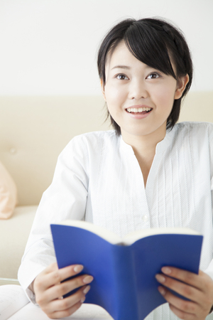 schoolwork: Girl to open a dictionary