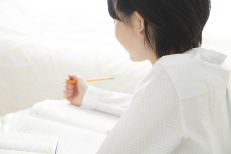 schoolwork: Girls study in the room