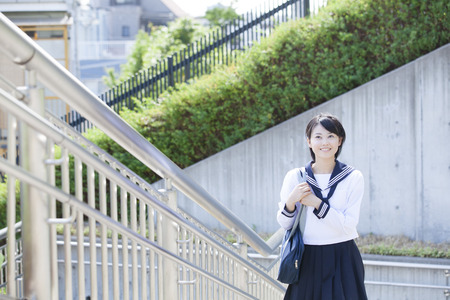 go up: Junior high school girls that go up the stairs Stock Photo