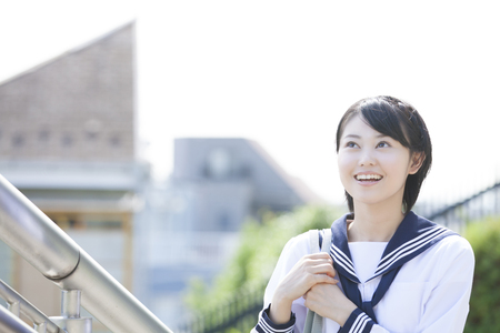 to go up: Junior high school girls that go up the stairs Stock Photo