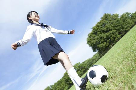 junior soccer: Junior high school girls kicking a soccer ball