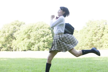 High school girls running the park