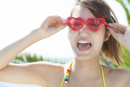 frolic: Women frolic and sunglasses Stock Photo