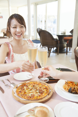 Woman to toast with sparkling wine