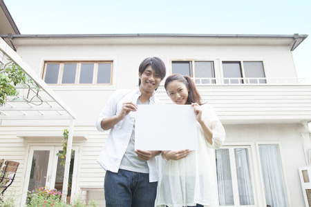 Couple smiling with a message board Stock Photo