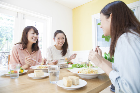 buddies: Women who eat pasta Stock Photo