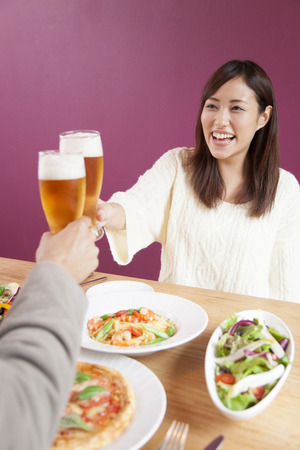 Couple toasting with beer photo
