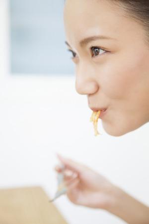 oneself: Women stuff oneself pasta