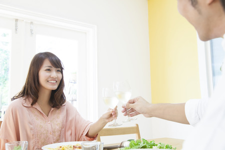 Couple to toast with white wine