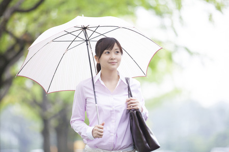 OL walking with an umbrella
