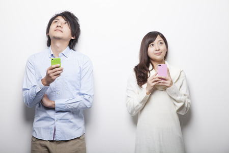 Men and women with a smartphone