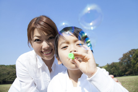 Mother and child playing with bubbles photo
