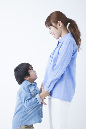 momma: Mother and child to each other staring hand in hand Stock Photo