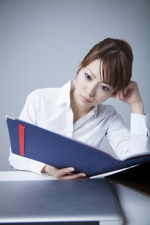 tiring: OL suffering to see the documentation Stock Photo