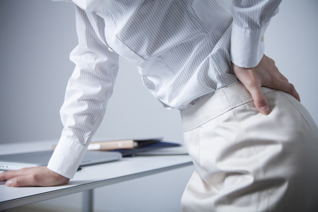 office lady suffering from low back pain 스톡 콘텐츠