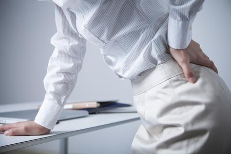 office lady suffering from low back pain Standard-Bild