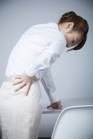 neuralgia: From behind the office lady who suffer from low back pain Stock Photo