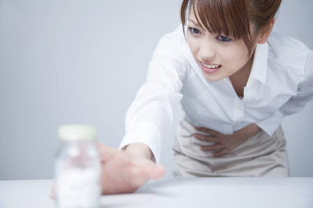 reach out: To reach out to the stomach medicine office lady Stock Photo