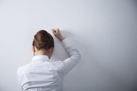 unhappy man: OL cry while hitting the wall Stock Photo