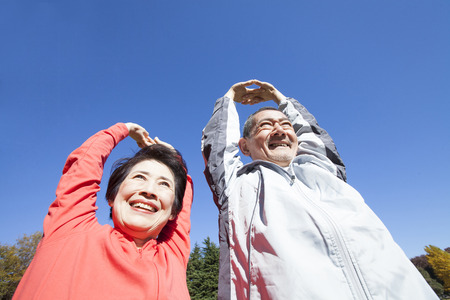 Senior couple stretching in the Park