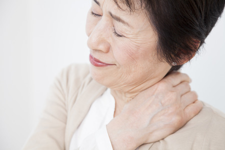 stiffness: Senior women suffer from stiff neck Stock Photo