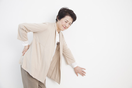 low back pain: Senior women who suffer from low back pain Stock Photo
