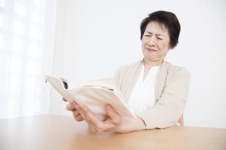hyperopia: Senior woman suffering from presbyopia