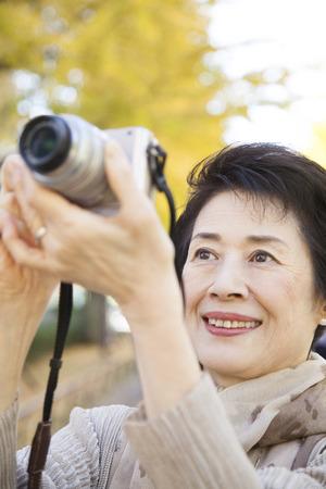 Senior women who set up a digital camera