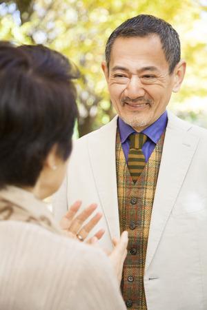 Senior couple chatting in Ginkgo biloba