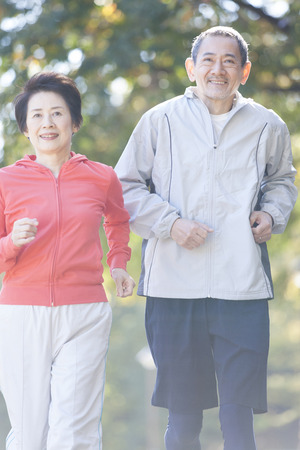 Senior couple jogging in the Park photo