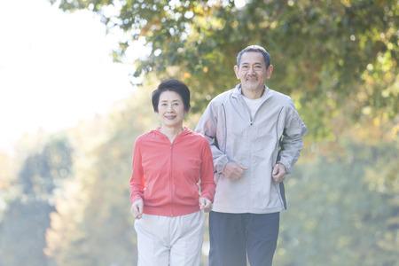 Senior couple jogging in the Park 写真素材