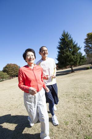 Senior couple jogging in the Park Stock Photo
