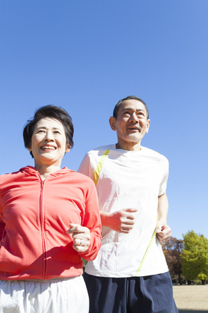salubrious: Senior couple jogging in the Park Stock Photo